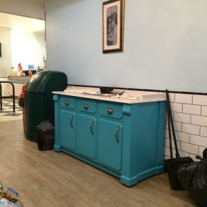 What a lovely chest - holding cleaning equipment and plastic forks! And those tiles and wall are rather good too